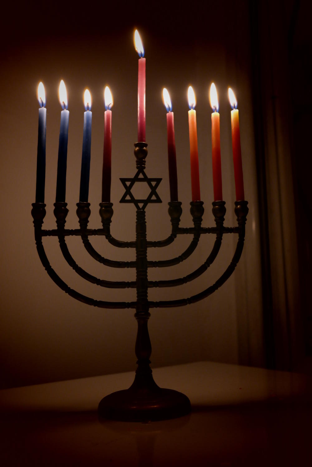 After every candle is lit, a family prepares to celebrate before Hanukkah ends.