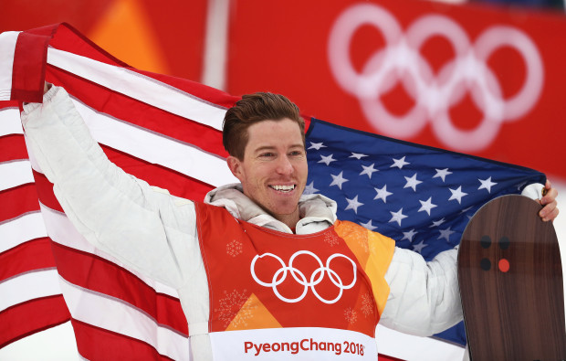 Shaun White filled with emotion as he represents America on the gold medalist stand.