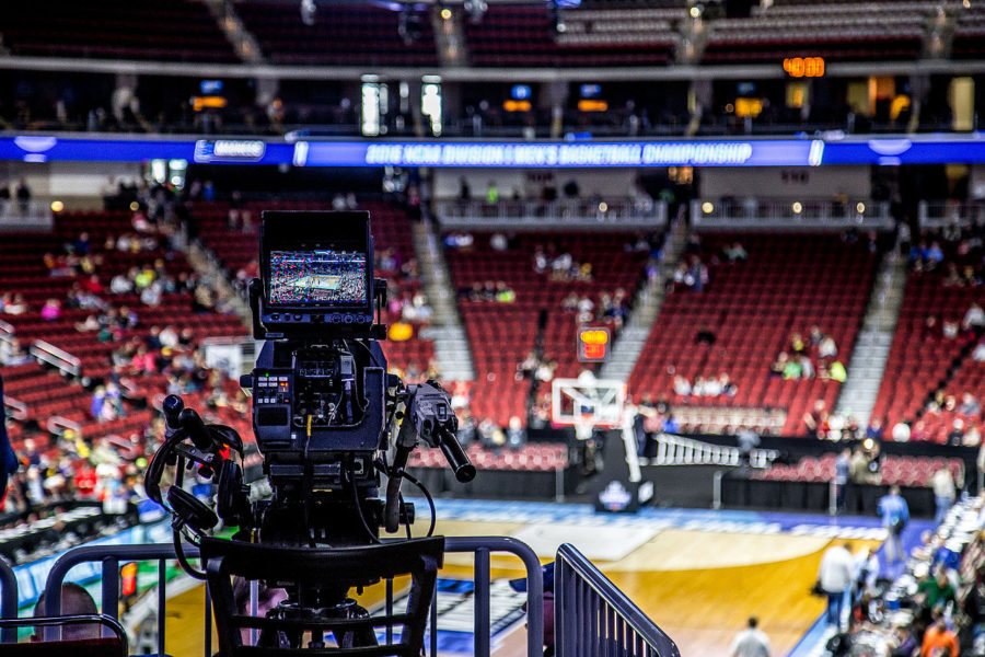 Cameras+are+rolling+on+the+court+as+the+Madness+kicked+off+with+the+Kansas+Jayhawks+were+practicing+for+the+tournament+at+the+Wells+Fargo+Arena.+