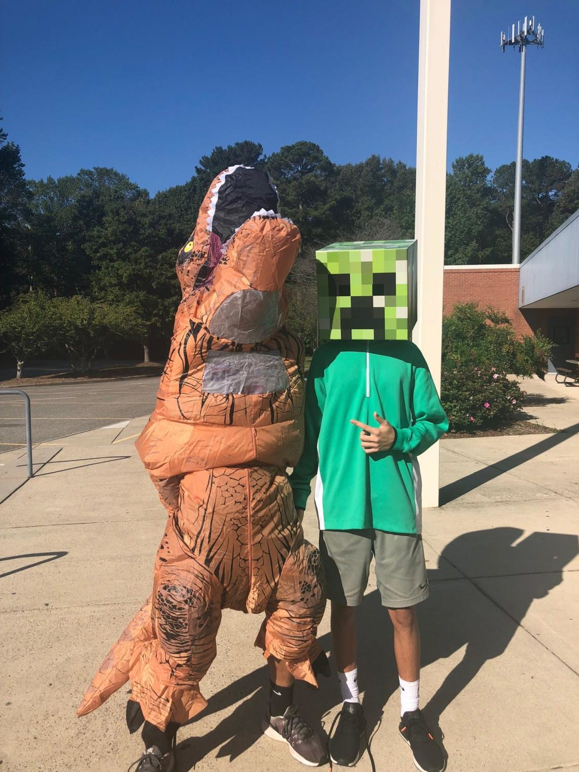 Dylan in the scary Creeper next to drew in the ferocious dinosaur dressed up accordingly for wildlife Wednesday.