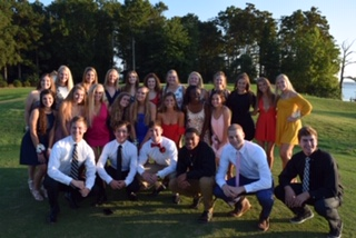 Seniors take pictures at Two Rivers Country Club before the dance.