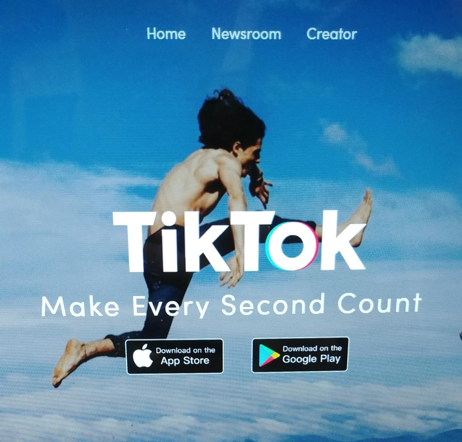 Tik Tok's main page displays their motto and ways to download the app.