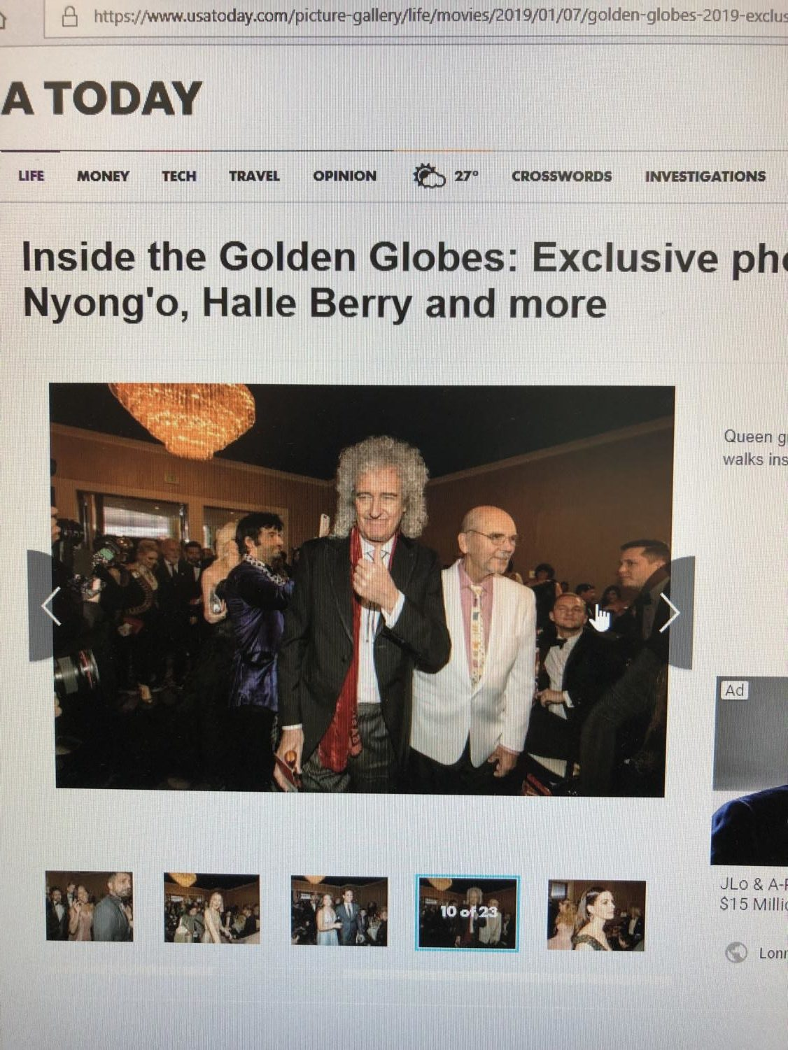 As the actors, actresses, musicians, and directors crowded the after party event, Queen guitarist Brian May gives a thumbs up to the camera and a dashing smile.
