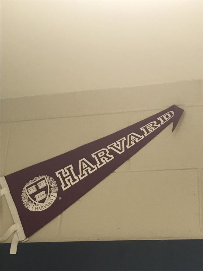 Sitting+above+the+student+body+at+Lafayette+High+School%2C+the+Harvard+banner+serves+a+prestigious+symbol