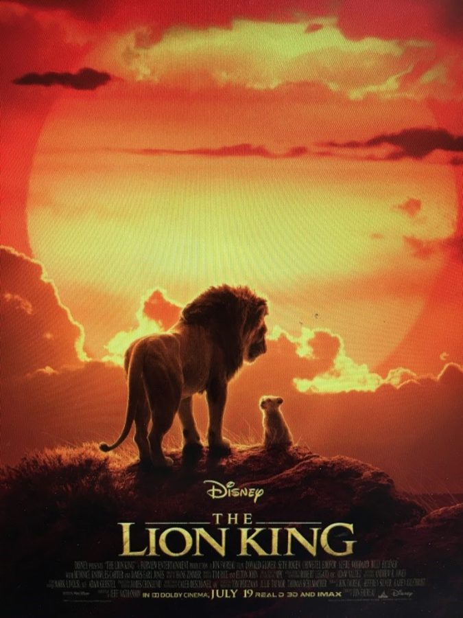 This+poster%2C+made+for+the+2019+remake+of+The+Lion+King%2C+can+be+seen+outside+of+many+theaters+to+entice+those+passing+by.