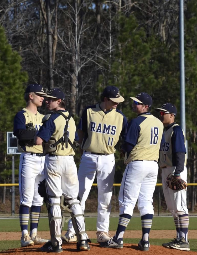 The Lafayette Rams take a timeout on the mound to make sure all of their signs are correct. The Rams need to make sure that their communication is in cinque so they are able to make the defensive plays during the game.