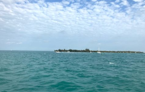 Beautiful blue waters on a gorgeous day in Key West Florida. While I was in Key West I took a boat ride 7 miles off shore to go snorkeling. Our destination was the Florida Keys Reef. During the 1 hour trip on the boat I took a picture and admired the breath taking views that Key West has to offer.