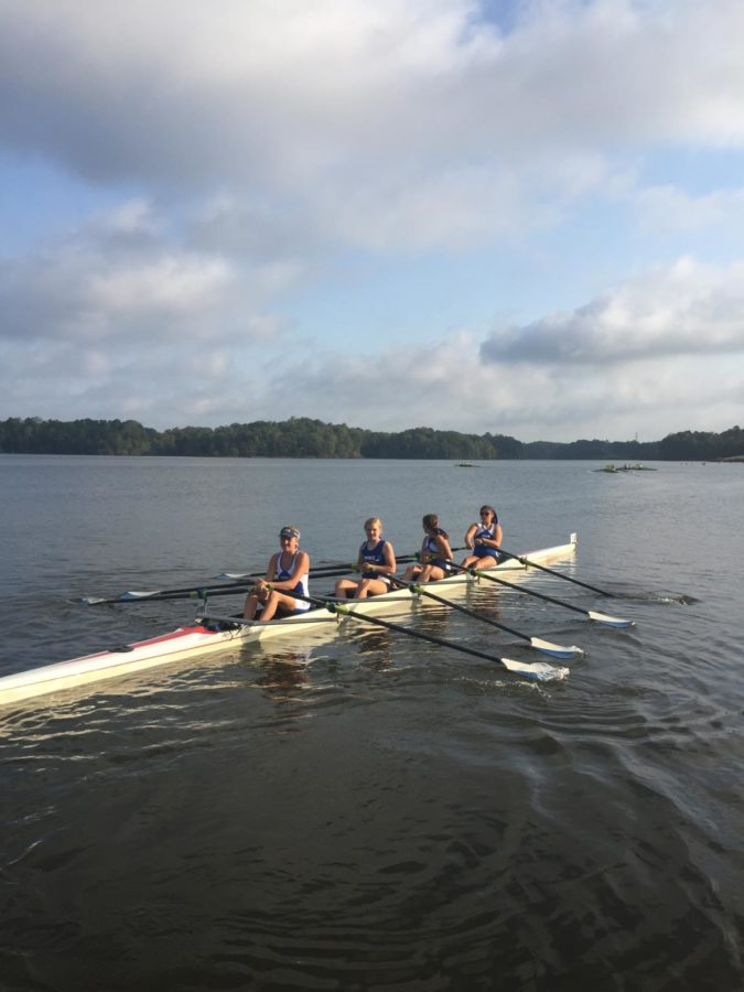 The+women%27s+quad+makes+its+way+to+the+starting+line.+These+rowers+have+been++practicing+every+weekday+for+two+hours+at+Chickahominy+State+Park.