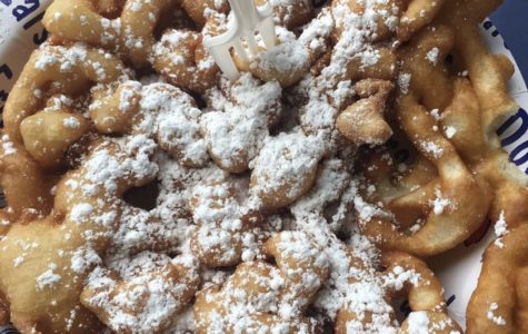 A quick break from the long journey, where I get to enjoy a flaky and sweet funnel cake in the city of England.