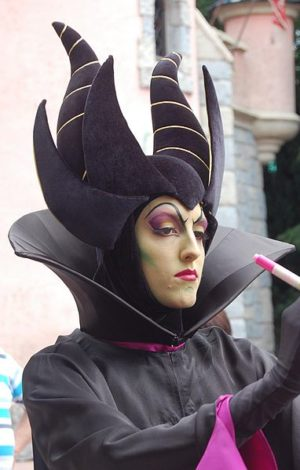 A young lady dresses up as Maleficent at Disney World.