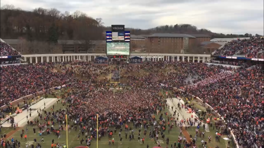 Virginia+fans+rush+the+Scott+Stadium+field+after+a+15+year+drought+against+Virginia+Tech.