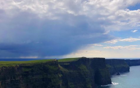The bag pipes softly played in the background as we watched the waves crash against the Cliffs of Moher.