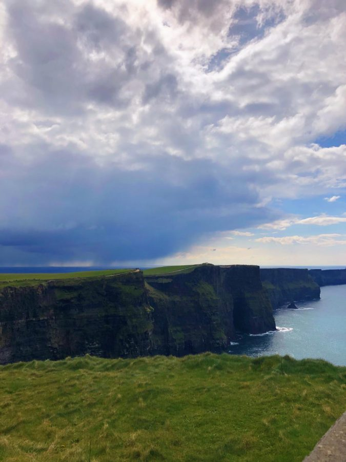The+bag+pipes+softly+played+in+the+background+as+we+watched+the+waves+crash+against+the+Cliffs+of+Moher.