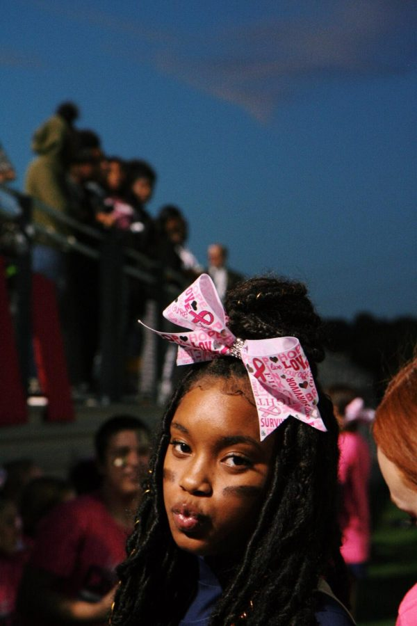 Asante Marrow posed for a quick picture while cheering on the sideline for her football team.