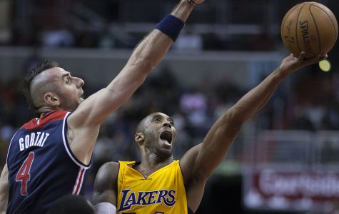 Kobe Bryant with the LAkers shooting aganist Marcin Fortat at the Washington Wizards game
