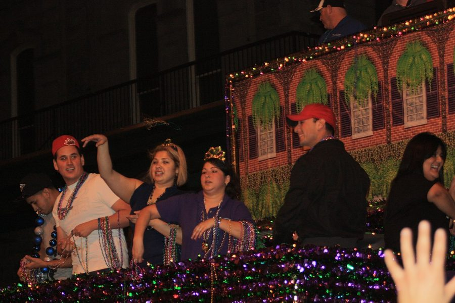 People+on+a+float+during+Mardi+Gras+in+Texas+immitating+the+traditions+in+New+Orleans%2C+Louisiana.