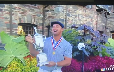 Bryson holding the US Open trophy