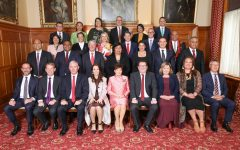Prime Minister Jacinda Ardern, first row and fourth from the left, poses for a photo with her cabinet members. These new appointments come after Ardern's reelection in a landslide victory last month.