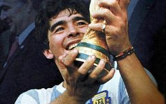 Maradona holds up the 1986 World Cup trophy after he and the Argentinian National Team defeated West Germany.