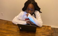 This young lady also enjoys being on her kitchen table while being on zoom. She attends Nansemond River High School.