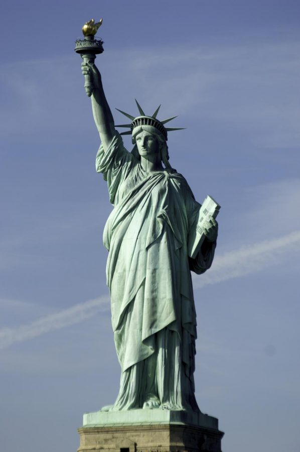 Once a symbol for economic freedom, Lady Liberty watches as Americas middle class is slowly destroyed.
