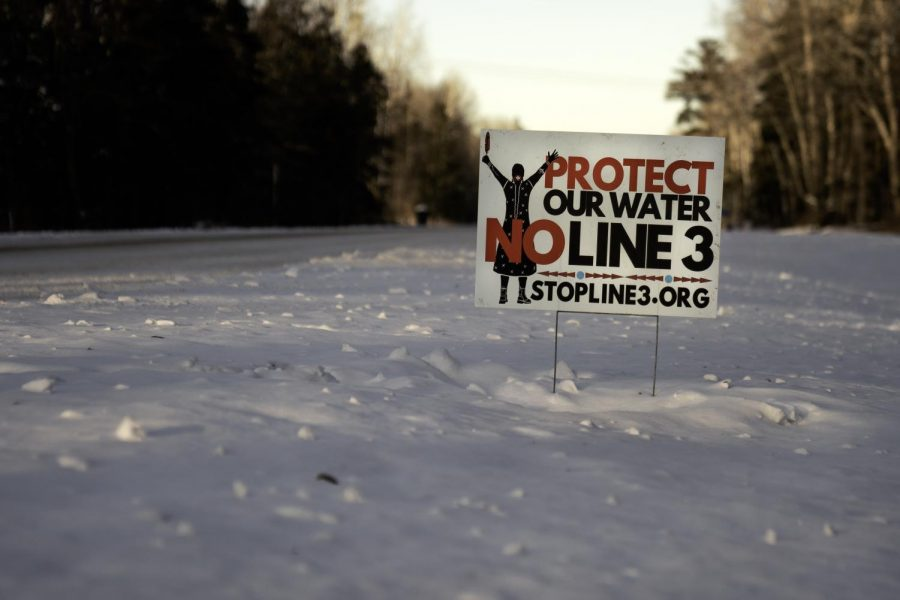 %22Protect+our+water%22+declares+a+sign+stuck+in+the+thick+Minnesota+snow.+