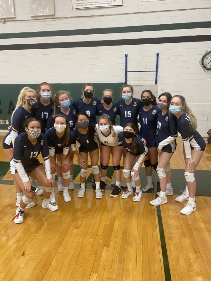 Lafayette's Varsity Volleyball team poses in their masks after their 3-0 victory against Jamestown. This was the first time since 2009 that LHS beat JHS.