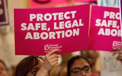 Those against the abortion ban have set to the streets in protest. One example of the signs that they hold is above, showing their distaste for the new law.