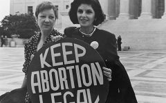 Norma McCorvey and her lawyer Gloria Allred stand in front of the Supreme Court in 1989.